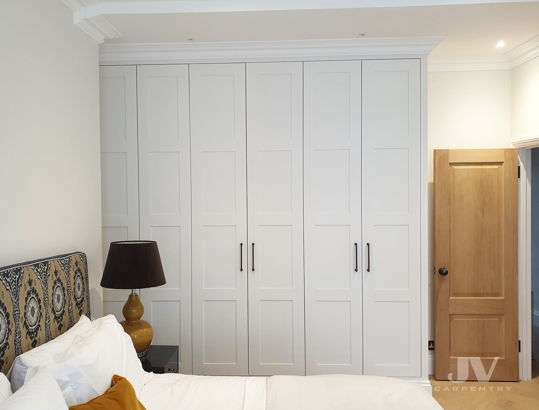 Fitted wardrobe reaching the ceiling