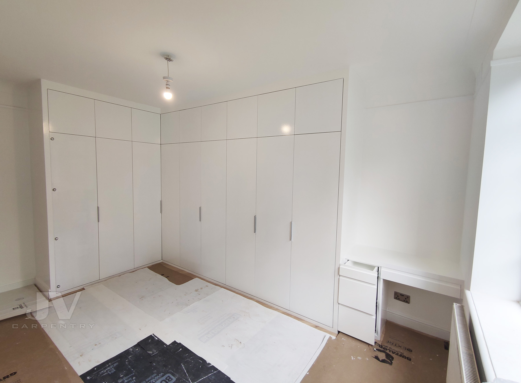 L shaped wardrobe with desk in white