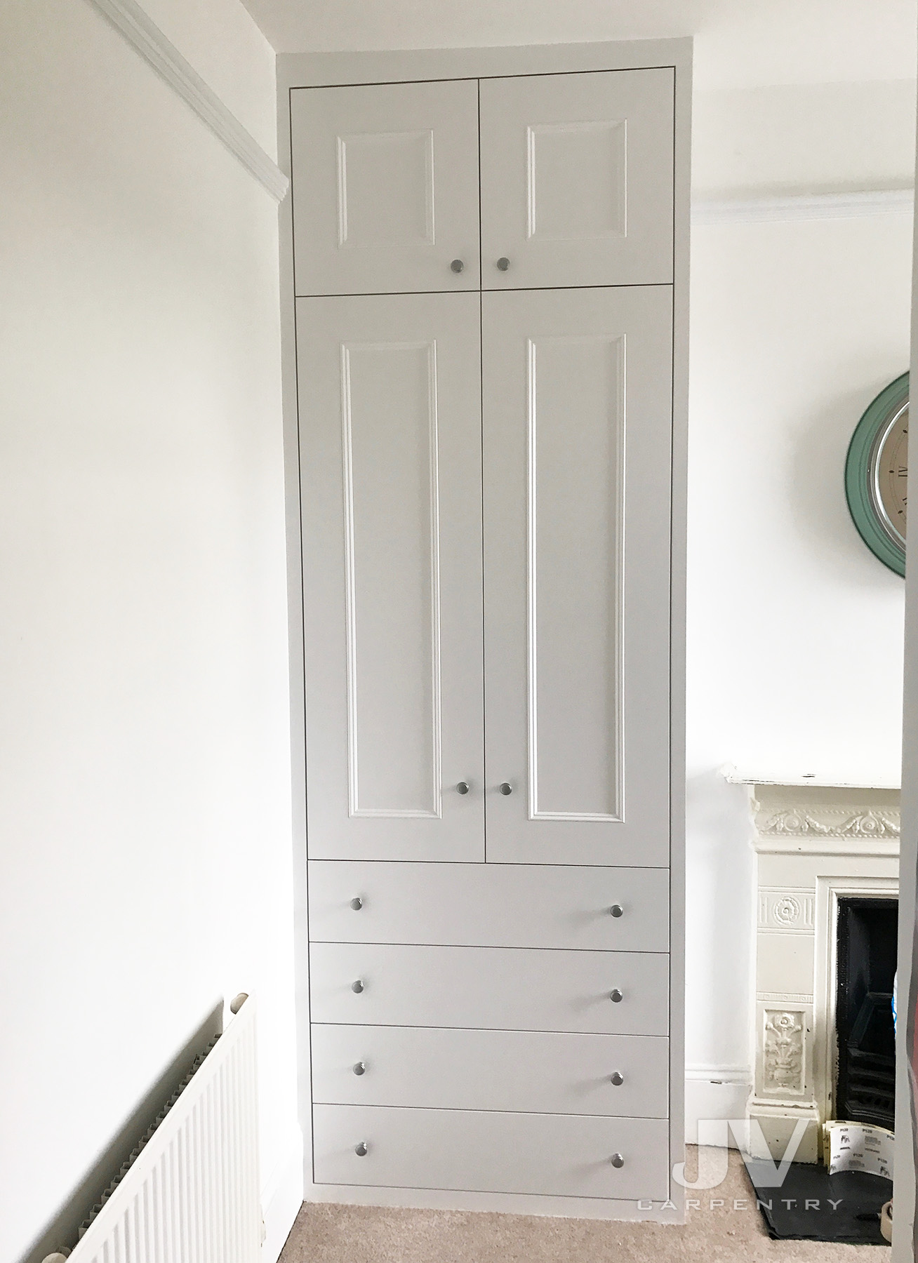 White fitted wardrobe with drawers