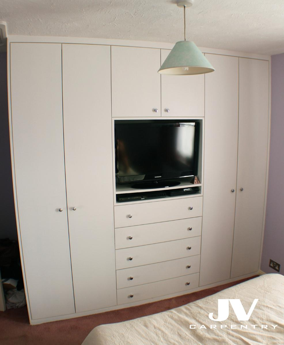 Fitted wardrobes jv carpentry for Bedroom designs with tv and wardrobe