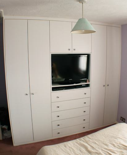 Fitted wardrobe with TV