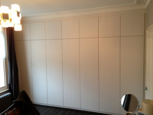 Fitted wardrobe with plain push to open doors