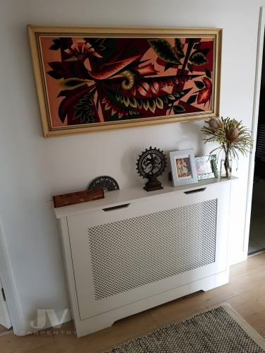Made-to-measure radiator cover