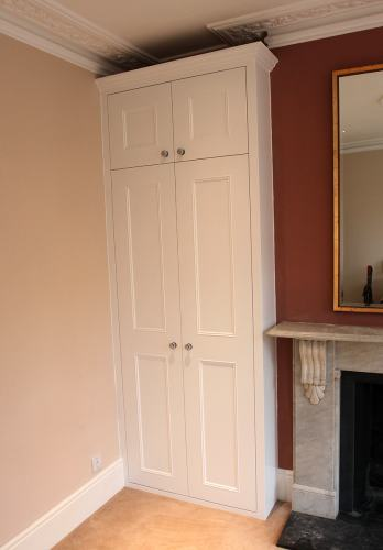 Bespoke wardrobe fitted into left alcove