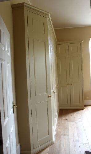 Traditional fitted wardrobe with angled door