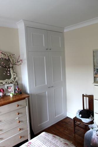 Bespoke alcove Wardrobe with coving to match existing