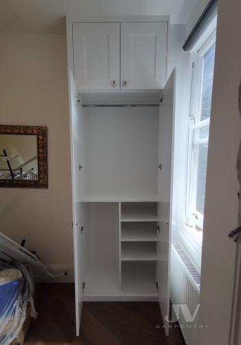inside an alcove wardrobe