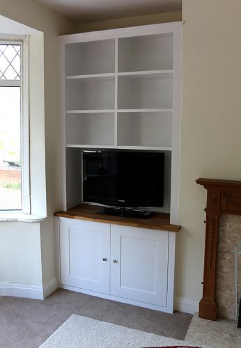 Living room fitted alcove with  oak top (LHS)