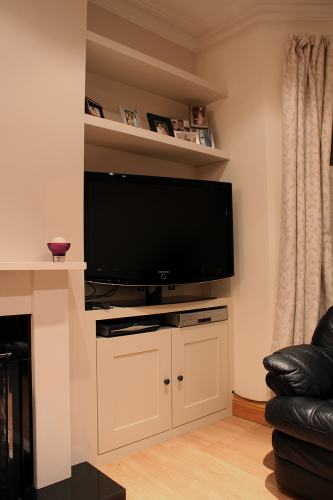 alcove tv cupboard and floating shelves