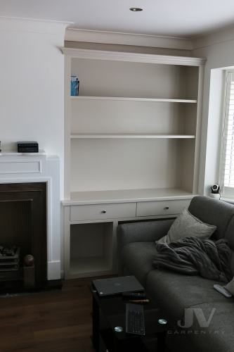 alcove unit with drawers and log store