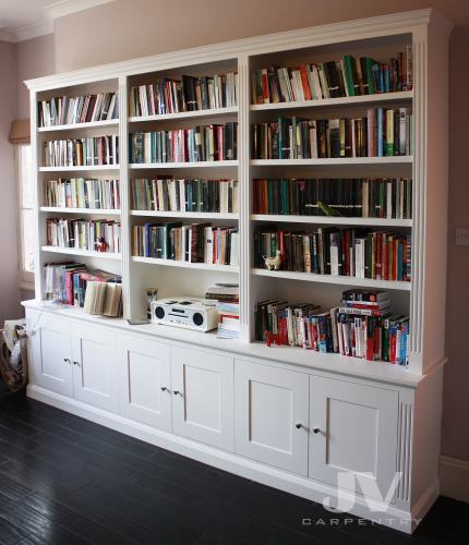 bookcase with illuminated shelves, light off