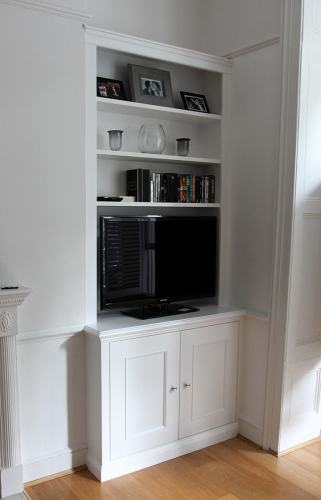 Fitted bookcase with cupboard