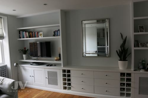 built-in bespoke shelves and cupboards with TV