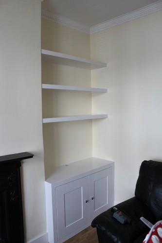 Bespoke alcove cabinet and floating shelves