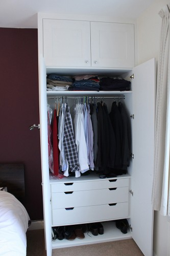 Alcove wardrobe with small drawer for ties