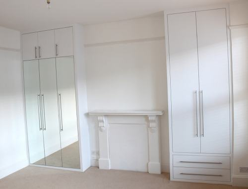 Fitted wardrobes with flush mirrored doors