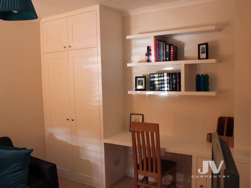 Built in wardrobe, home office desk and smart floating shelves above the desk