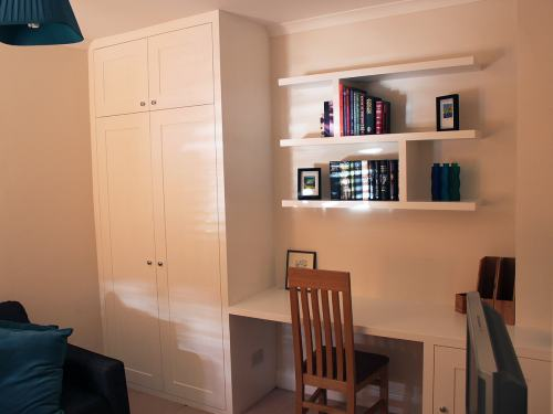 Fitted wardrobe with floating shelves and desk