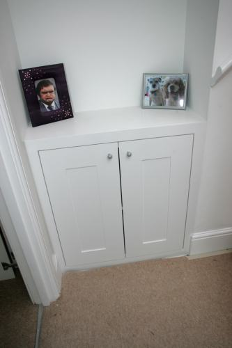 fitted alcove cupboard