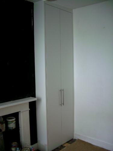 Tall fitted wardrobe with long plain doors