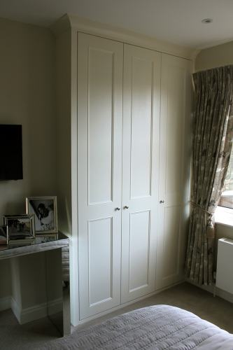 fitted wardrobe with three shaker beaded doors