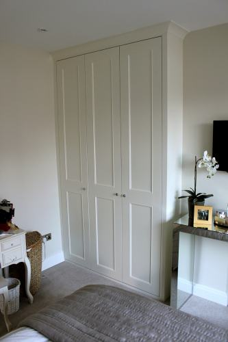fitted wardrobe with coving and long shaker with panel mouldings doors