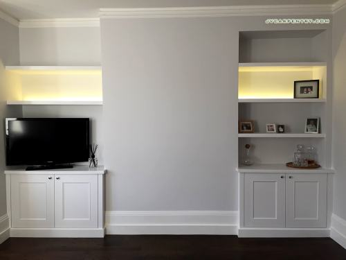 Two alcove bookshelves with lights
