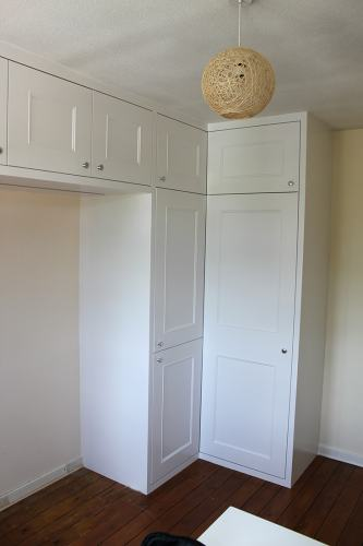 L shaped wardrobe with top cupboards