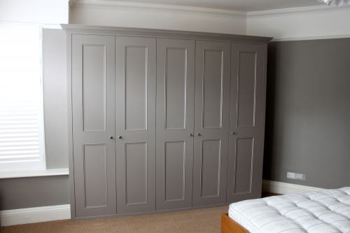 Fitted wardrobe painted grey colour with shaker beaded doors