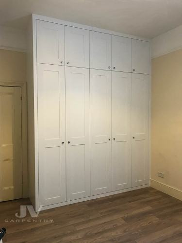 Tall custom wardrobe with 5 doors