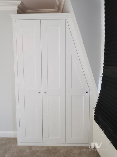 alcove wardrobe with sloping ceiling