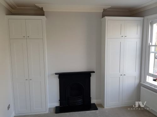 Traditional built-in wardrobes fitted into an alcoves